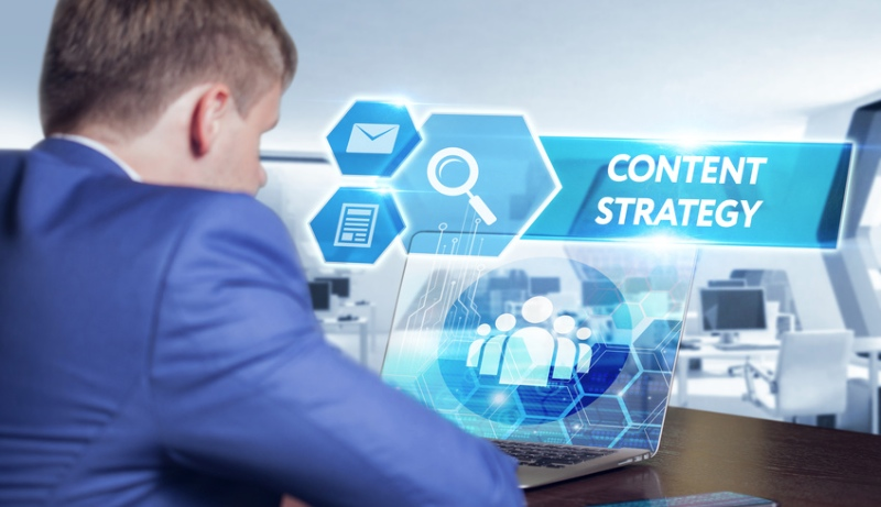 Man at Computer Desk with Text that says Content Strategy