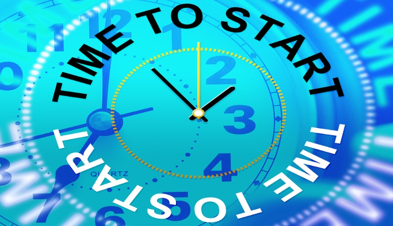 Time To Start with clock on blue background