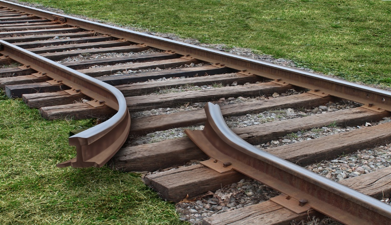 Train track that is bent and will cause derailment