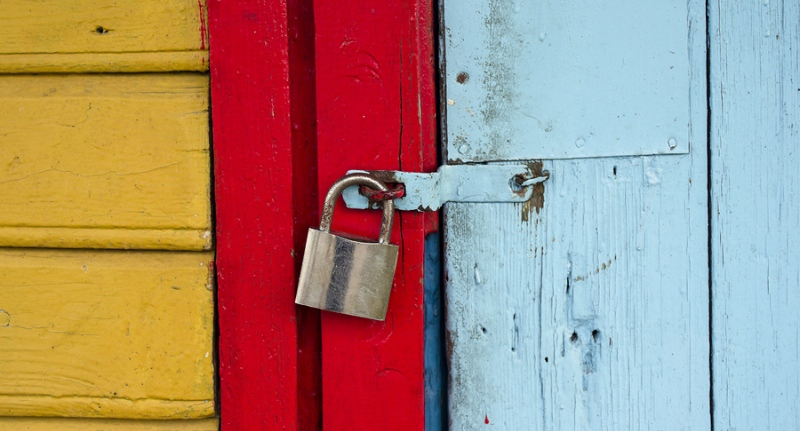 Colorfully painted wooden door with padlock